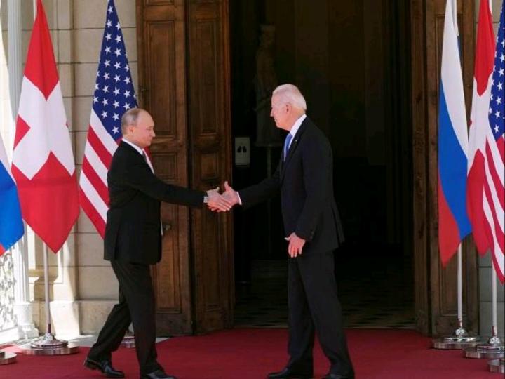 Russian President Vladimir Putin and US President Joe Biden shake hands during their meeting at Villa la Grange in Geneva, Switzerland