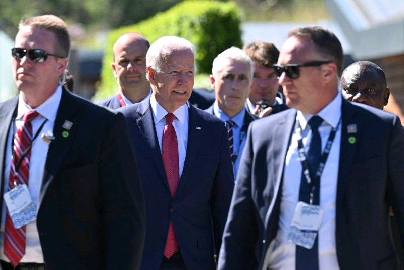 U.S. President Joe Biden talks with South Africa's President Cyril Ramaphosa as they arrive for a working session during G7 summit in Carbis Bay, Cornwall, Britain