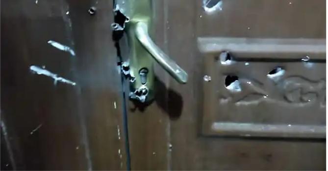 Bullet holes on door