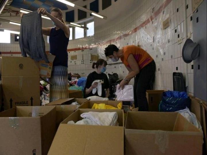 Civilian volunteers sort donations for evacuees from Afghanistan